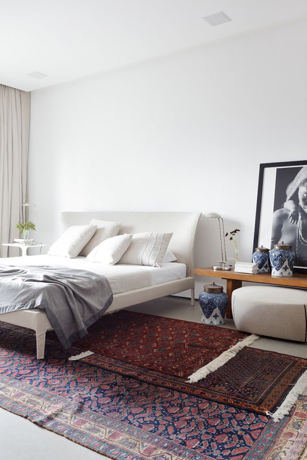 layering rugs Turkish art collectors apt Brazil bedroom via Yatzer. STYLING TIPS Layering Rugs  4 Ways   Erika Brechtel