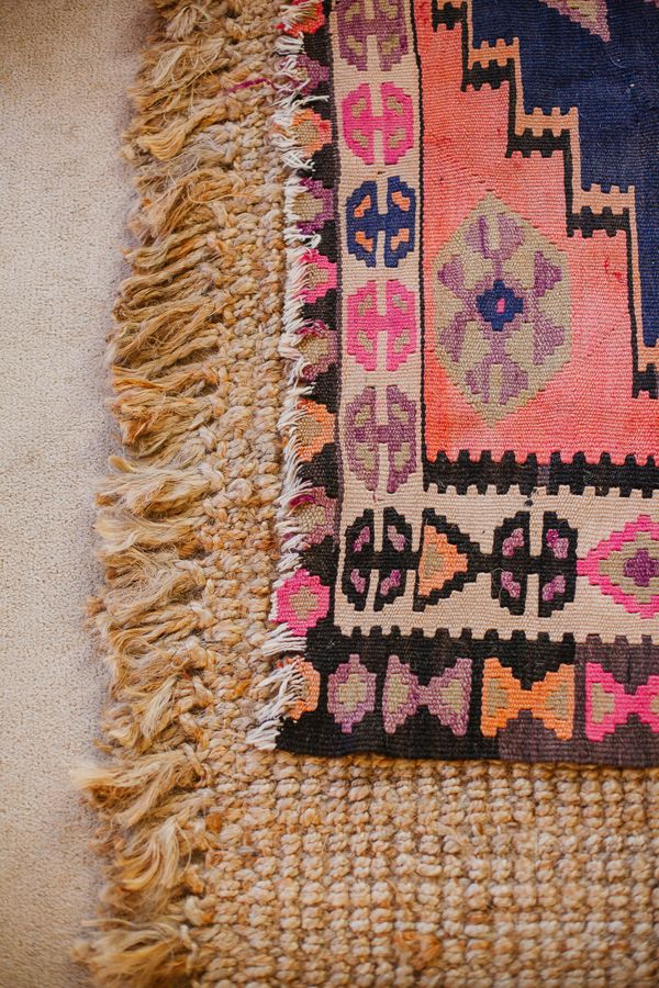 layering rugs kilim over natural via Glitter Guide