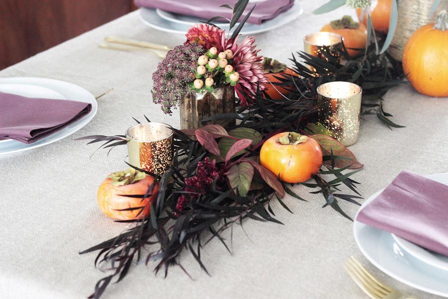 Thanksgiving table centerpiece DIY Erika Brechtel flowers persimmon candles plum napkins