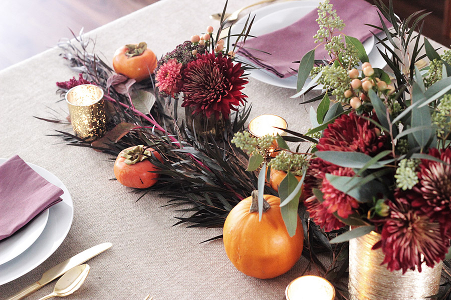 Thanksgiving table centerpiece DIY Erika Brechtel flowers persimmon candles table left