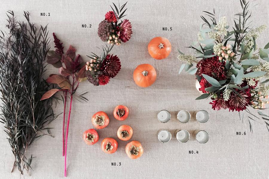 Thanksgiving table centerpiece DIY Erika Brechtel flowers persimmon foliage pumpkins supplies
