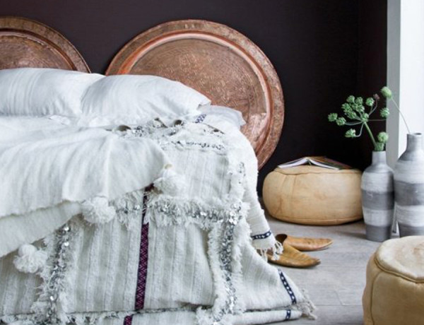 copper interiors bedroom black wall Moroccan wedding blanket by El Ramla Hamra feat
