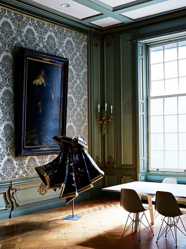 Viktor & Rolf Amsterdam HQ boardroom teal mint wall paneling damask wallpaper Eames chair Vitra table