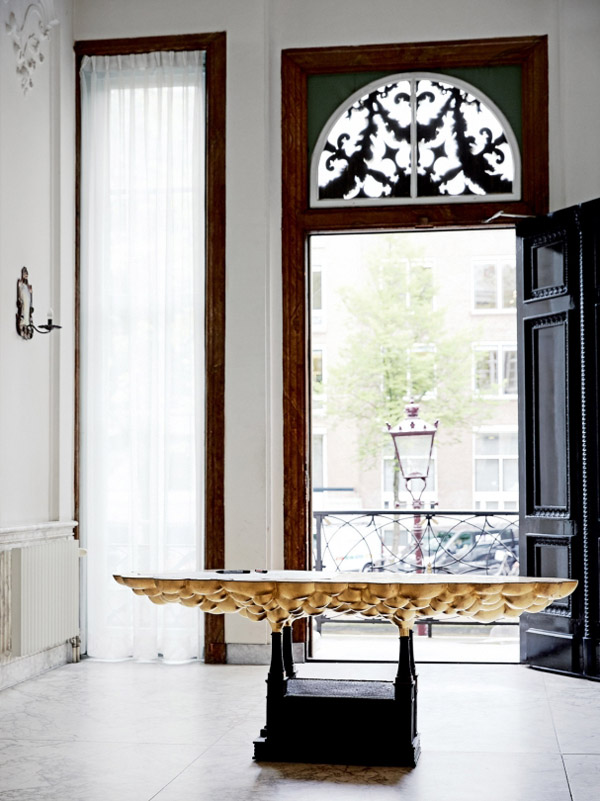 Viktor & Rolf Amsterdam HQ entry black door gold table