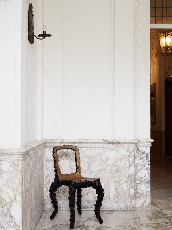 Viktor & Rolf Amsterdam HQ entry white marble floors wainscoat