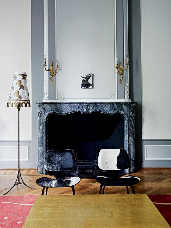Viktor & Rolf Amsterdam HQ garden room Eames cowhide chairs black marble fireplace