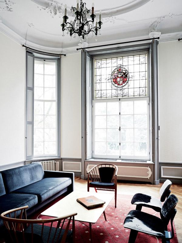 Viktor & Rolf Amsterdam HQ garden room chandelier velvet soda Eames cowhide chairs