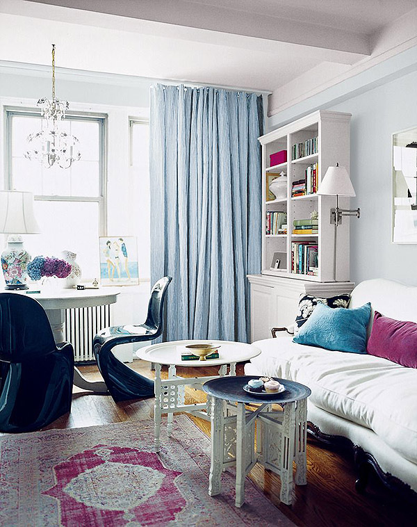 black Panton S chair Rashida Jones NYC apt white blue Turkish rug Moroccan tables via Domino