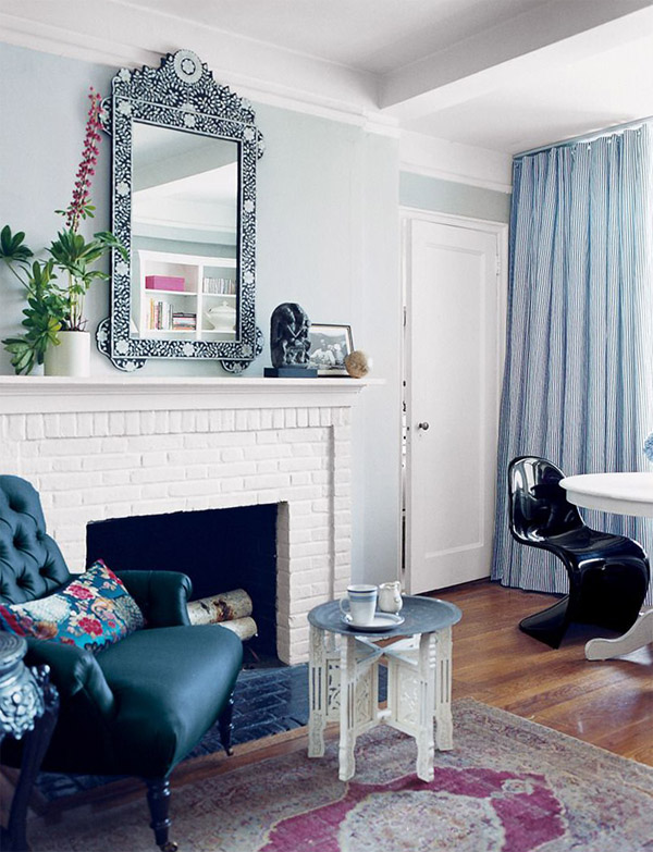 black Panton S chair Rashida Jones NYC apt white brick fireplace via Domino