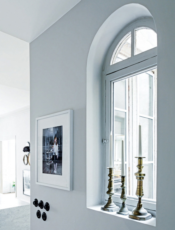 designer room tricks antique candlesticks on a window sill by Maison Hand photo by Felix Forest via Vogue Living