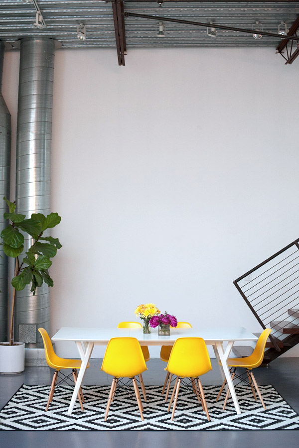 Mavens HQ Citrus Studios Kalika Yap office loft styled by Erika Brechtel conference table yellow Eames chairs