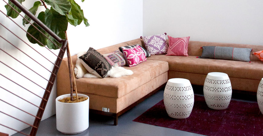 Mavens HQ Citrus Studios Kalika Yap office loft styled by Erika Brechtel corner sofa boho pillows garden stools feat