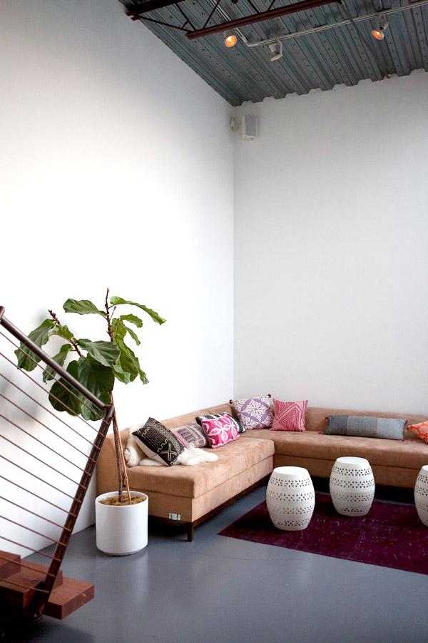 Mavens HQ Citrus Studios Kalika Yap office loft styled by Erika Brechtel corner sofa boho pillows garden stools fiddle leaf fig