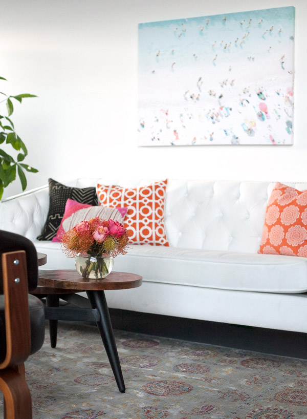 Mavens HQ Citrus Studios Kalika Yap office loft styled by Erika Brechtel lobby beach painting white sofa coral black white wood table