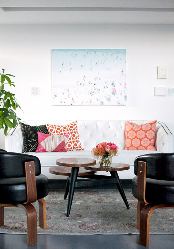 Mavens HQ Citrus Studios Kalika Yap office loft styled by Erika Brechtel lobby beach painting white sofa coral black white