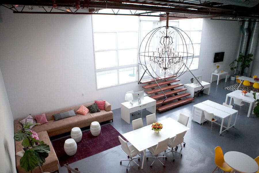 Mavens HQ Citrus Studios Kalika Yap office loft styled by Erika Brechtel white desks chairs Timothy Oulton chandelier corner sofa boho pillows