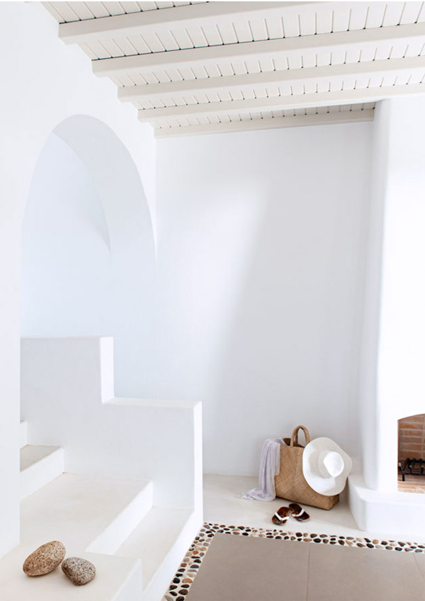 Greece Cyclades Mykonos interiors architecture Agnandi via Style Files entry white stucco stairs fireplace open beam