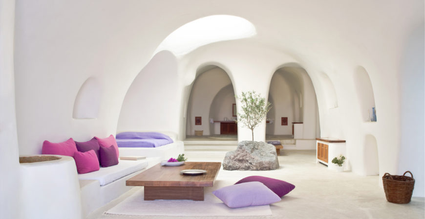 Greece Cyclades Oia interiors architecture Perivola Suites living room white minimalist purples