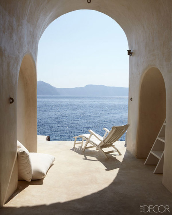 Greece Cyclades Therassia interiors architecture by Costis Psychas via Elle Decor arch ocean view white stucco patio