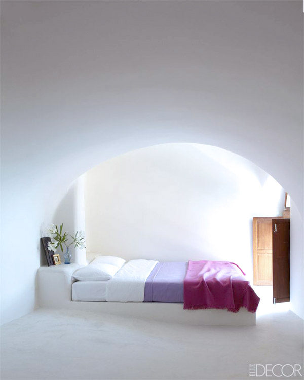 Greece Cyclades Therassia interiors architecture by Costis Psychas via Elle Decor white bedroom arch minimalist wood window shutters