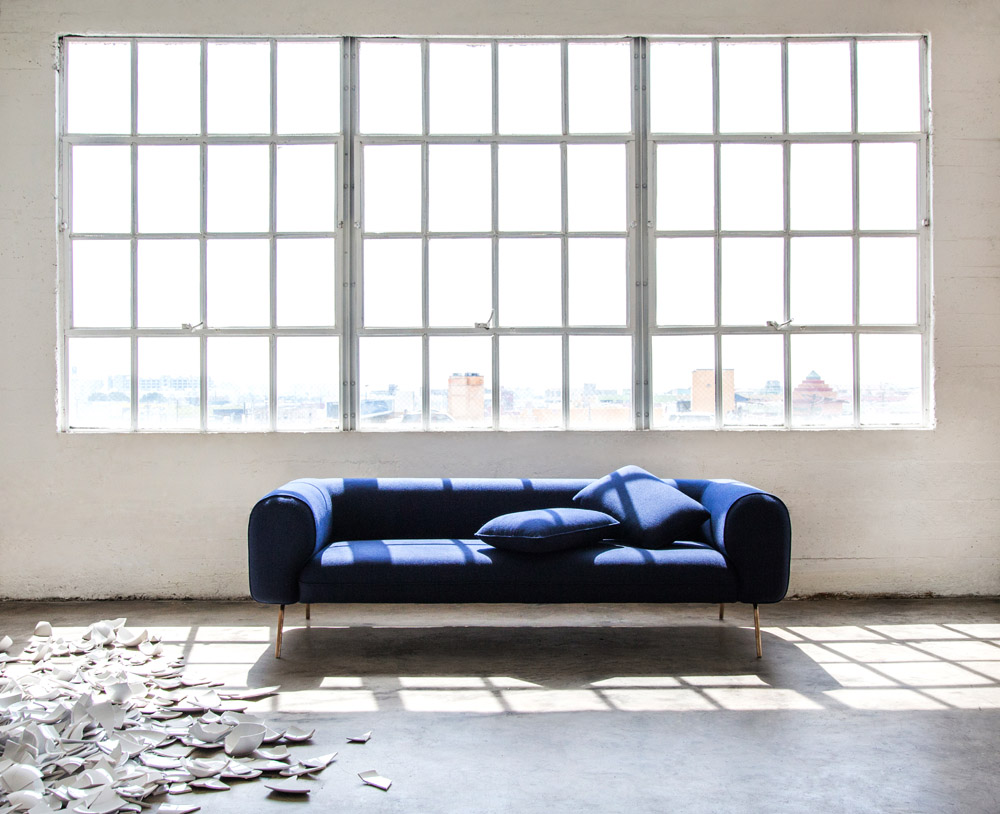 Capsule Home photo shoot Erika Brechtel photo by Tessa Neustadt LA loft big arm sofa broken plates