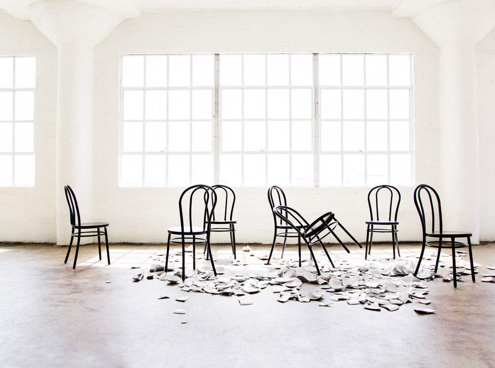 Capsule Home photo shoot Erika Brechtel photo by Tessa Neustadt LA loft broken plates black Marie chairs