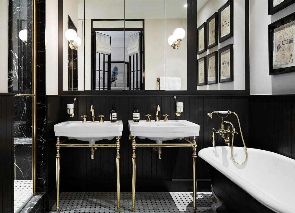 parisian-glam-laura-gonzalez-bathroom-black-marble-white-gold-sinks-penny-tile