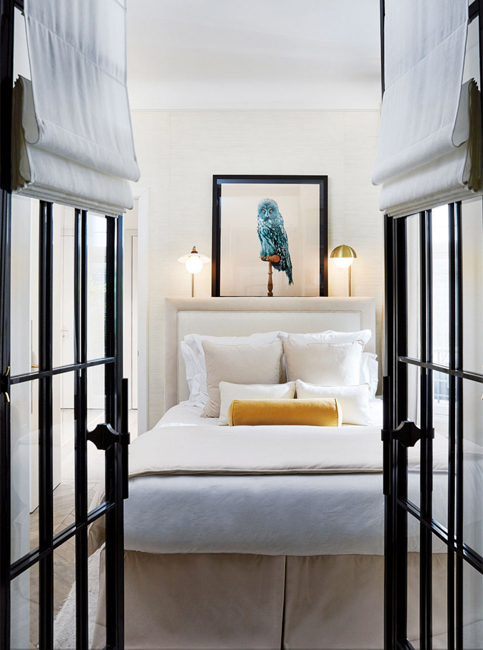 parisian-glam-laura-gonzalez-bedroom-black-paned-doors-white-ivory-brass-lamps