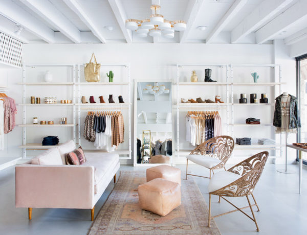 Adelante Boutique by Claire Zinnecker pink couch white gold peach natural peacock bucket chairs
