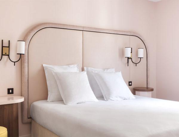 Hotel Bienvenue room blush walls deco 70s yellow stool